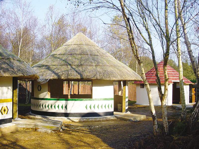 African_hut_thatched_roof_protected_with_fire_barrier_curtain3