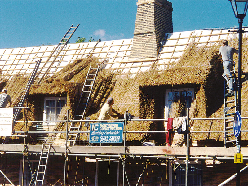 Thatched_roof_protection_with_fire_barrier_curtain